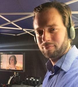 Garrett Strommen working on set as an Italian dialect coach